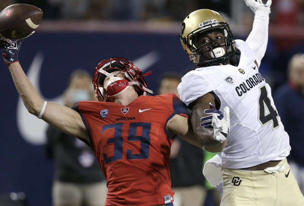Colorado defensive back Chidobe Awuzie (4) defends Arizona wide receiver Tony Ellison during the second half of an NCAA college football game, Saturday, Nov. 12, 2016, in Tucson, Ariz. Awuzie was called for pass interference. (AP Photo/Rick Scuteri)