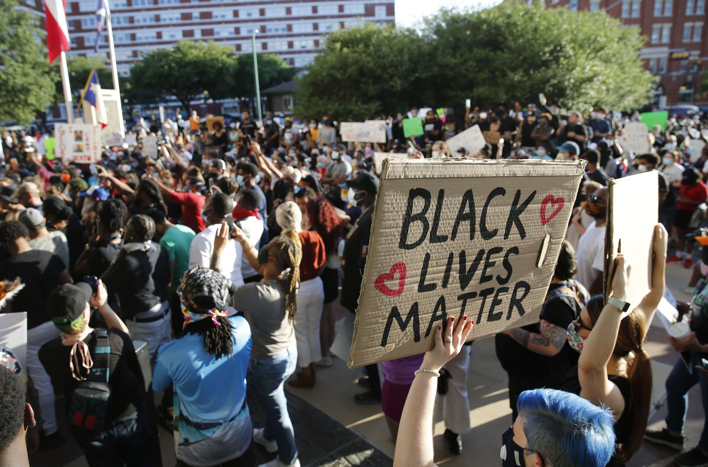 Protesters rally during a demonstration against police brutality in front of Dallas Police Department Headquarters in downtown Dallas, on Friday, May 29, 2020. George Floyd died in police custody in Minneapolis on May 25.