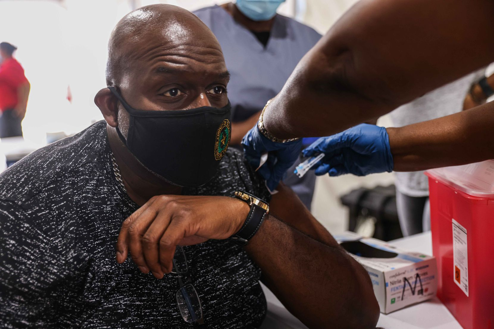 David Penelton, 53, gets a booster COVID-19 shot offered by the Dallas County at the State Fair of Texas during its opening day in Dallas on Friday, September 24, 2021.