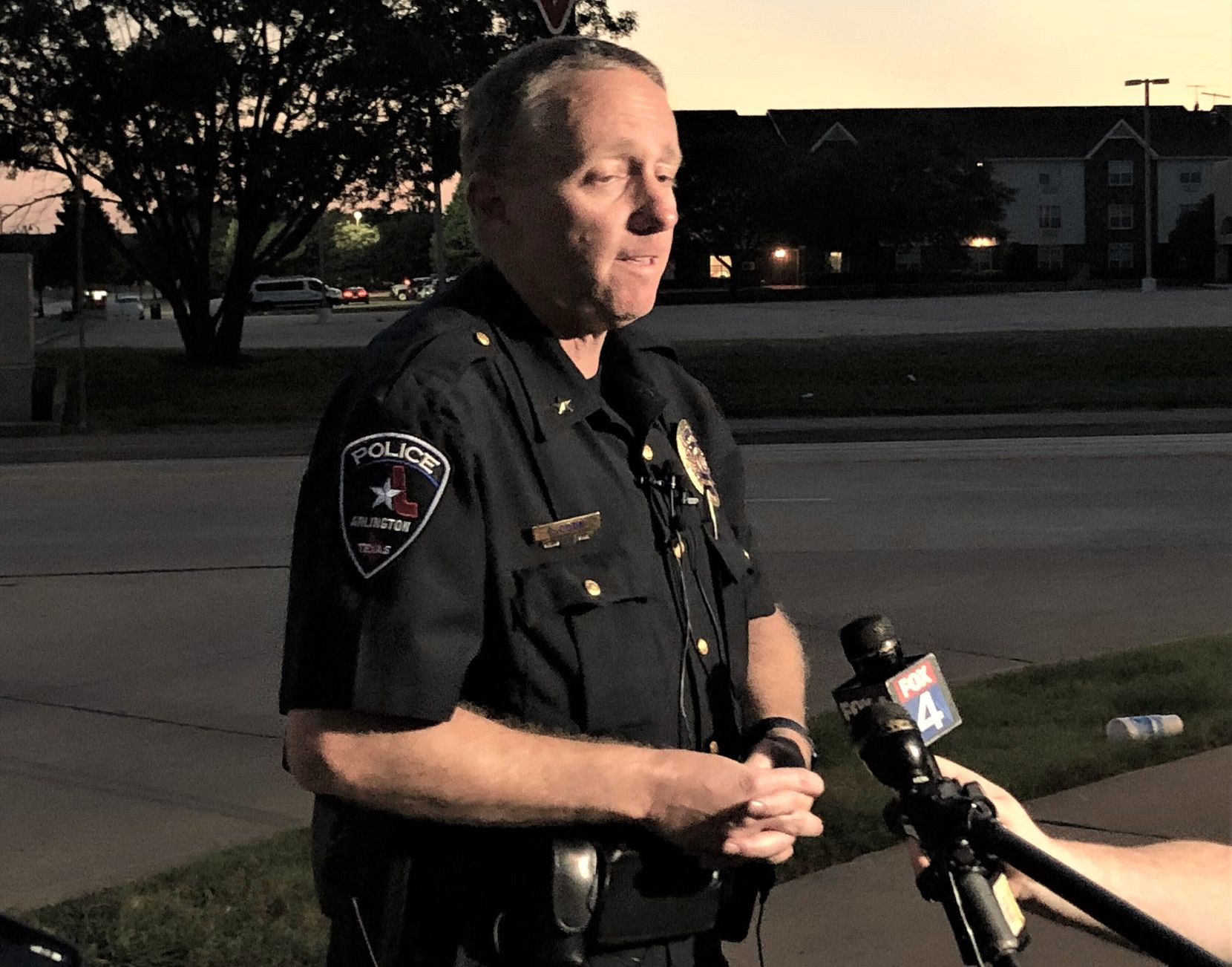 Arlington police Deputy Chief Christopher Cook said an officer was trying to break up a fight outside the Hurricane Harbor entrance when he heard a gunshot and saw the victim.