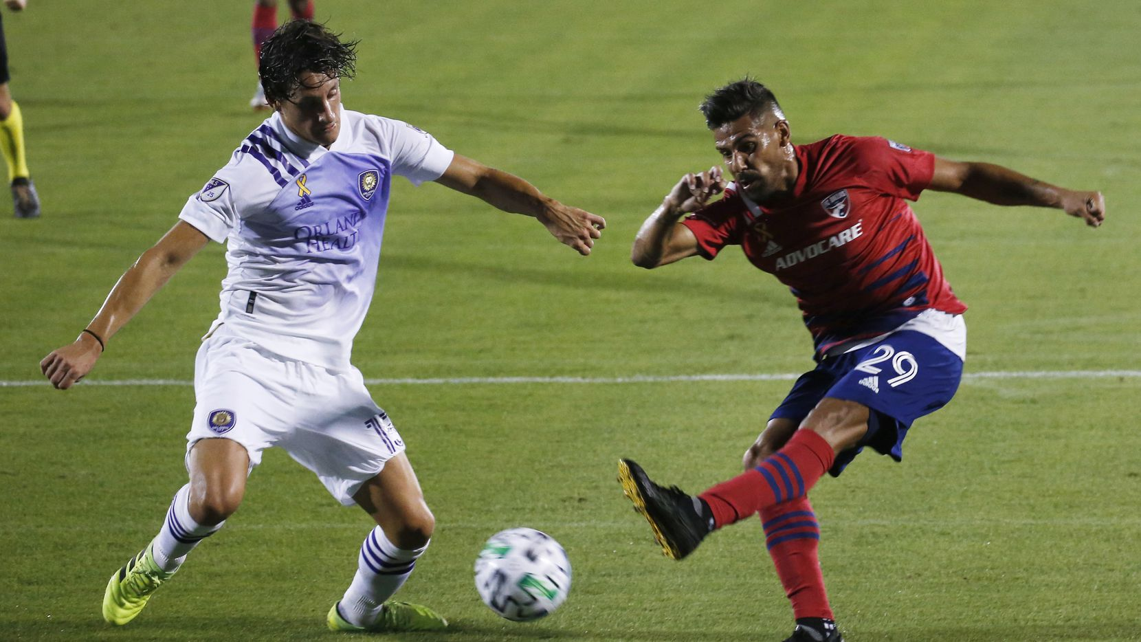 FC Dallas forward Franco Jara (29) attempts a shot in front of Orlando City defender Rodrigo Schlegel (15) during the first half of play at Toyota Stadium in Frisco, Texas on Sunday, September 27, 2020.
