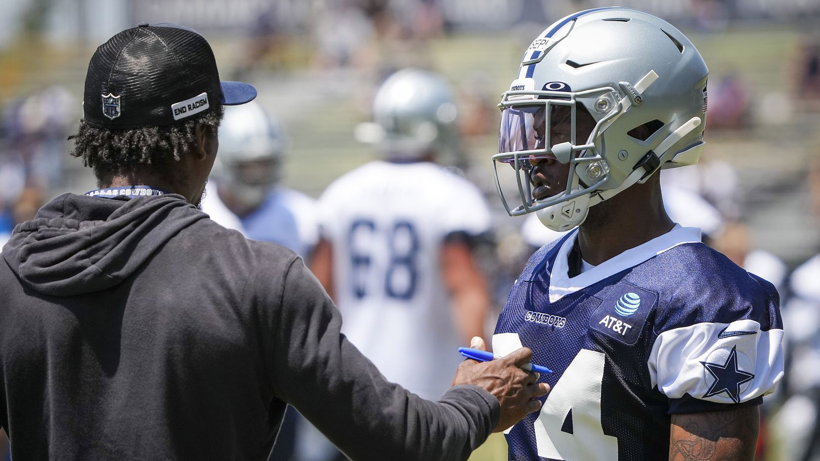 Dallas Cowboys cornerback Kelvin Joseph (24) works with defensive backs coach Al Harris during a practice at training camp on Tuesday, July 27, 2021, in Oxnard, Calif.