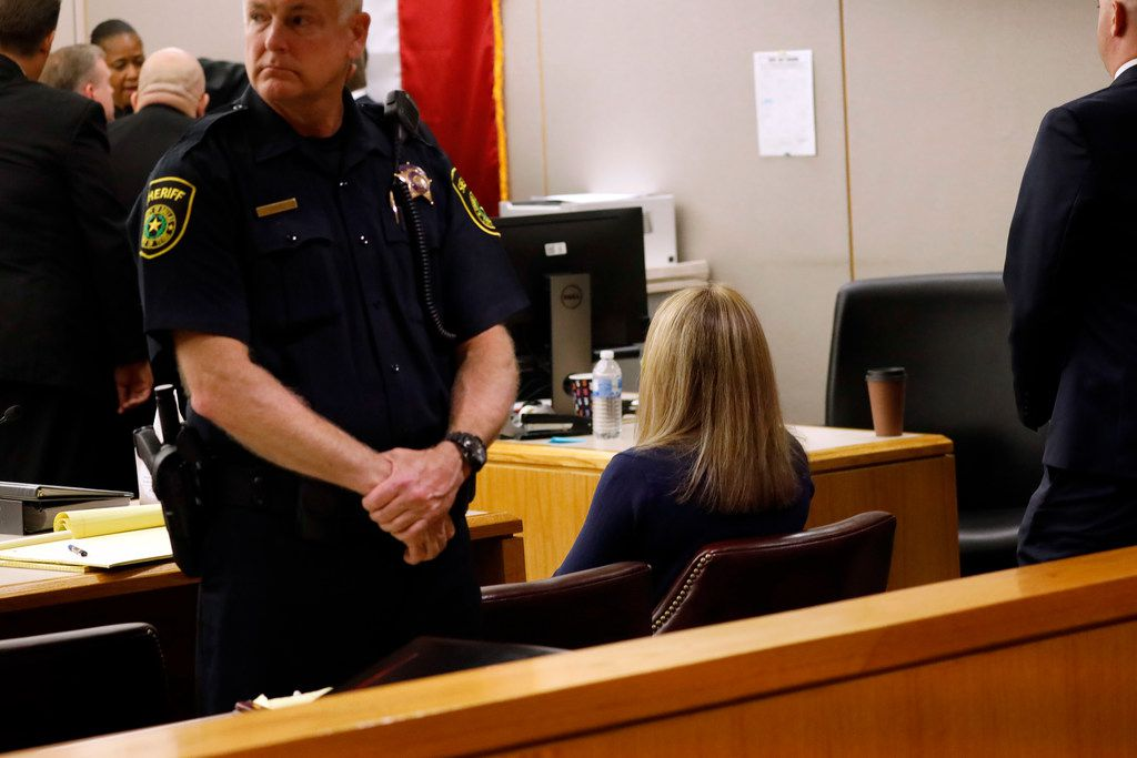 Fired Dallas police Officer Amber Guyger sits alone after being found guilty of murder Tuesday.