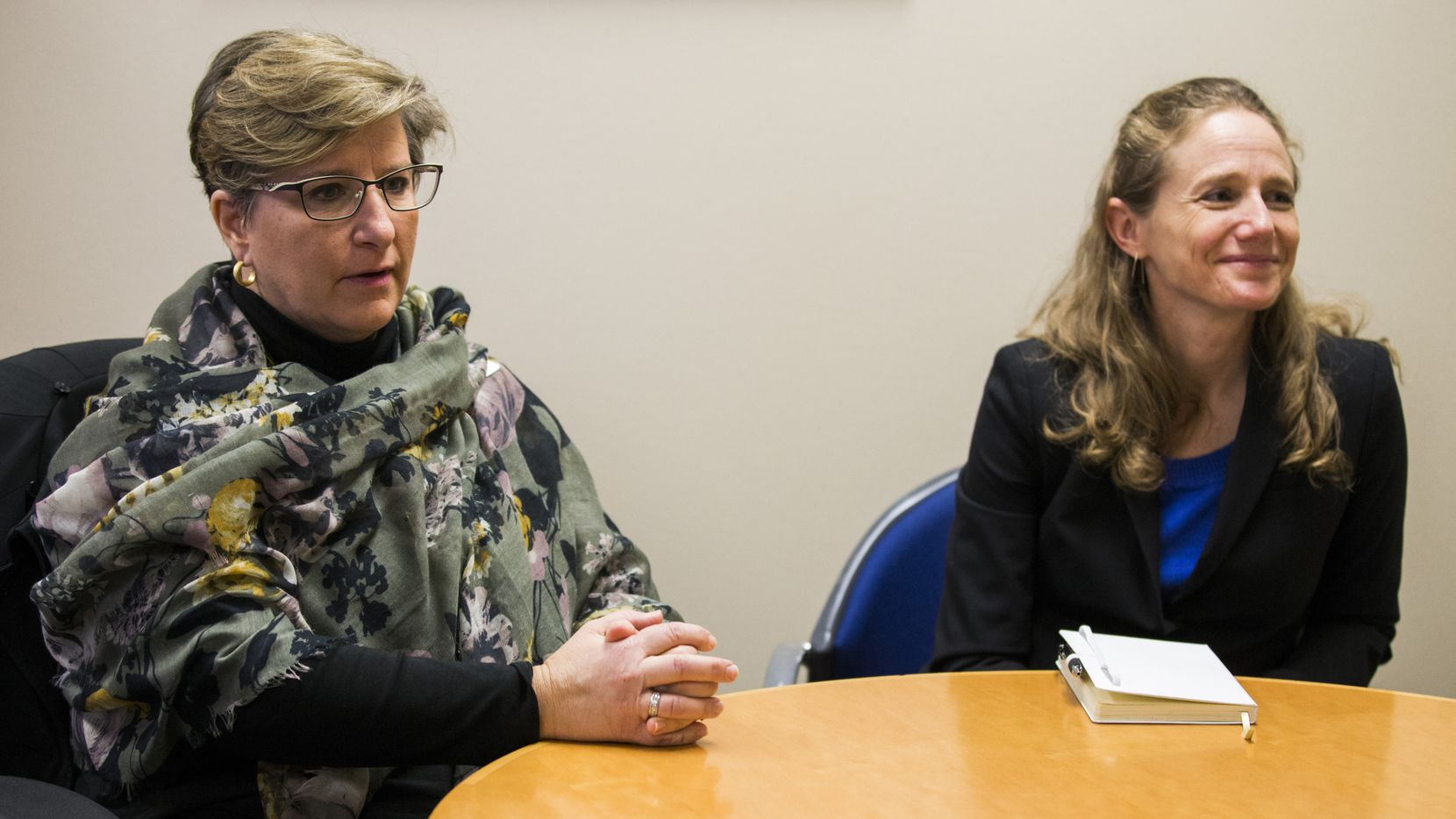 Suzy Cop (left), executive director at International Rescue Committee in Dallas, and Shayna Kessler, senior planner at the Vera Institute's Center on Immigration and Justice, discuss a deportation defense fund on Tuesday, February 11, 2020 at International Rescue Committee in Dallas. (Ashley Landis/The Dallas Morning News)