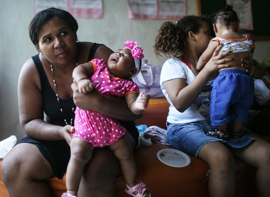RECIFE, BRAZIL - JUNE 02:  Infants born with microcephaly are held by mothers and family members as they attend a meeting for mothers of children with special needs on June 2, 2016 in Recife, Brazil. The meeting was conducted by the group AMAR which provides support for mothers and families of children with deficincies. Microcephaly is a birth defect linked to the Zika virus where infants are born with abnormally small heads. The Brazilian city of Recife and surrounding Pernambuco state remain the epicenter of the Zika virus outbreak, which has now spread to many countries in the Americas. A group of health experts recently called for the Rio 2016 Olympic Games to be postponed or cancelled due to the Zika threat but the WHO (World Health Organization) rejected the proposal.  (Photo by Mario Tama/Getty Images)