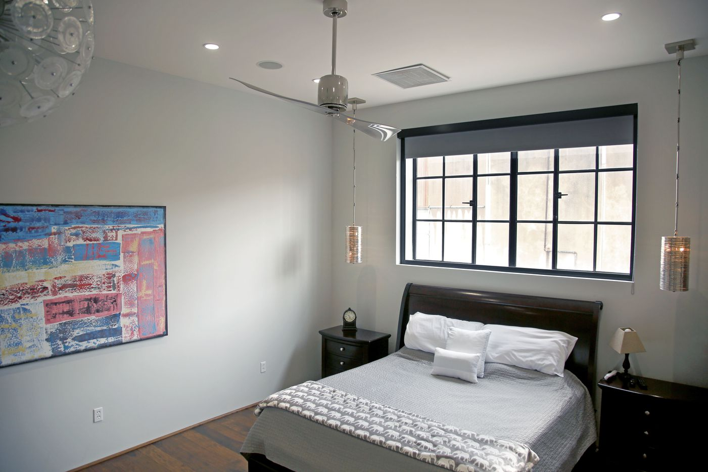 The master bedroom is pictured in one of two loft homes in converted warehouse space in Dallas' Design District.