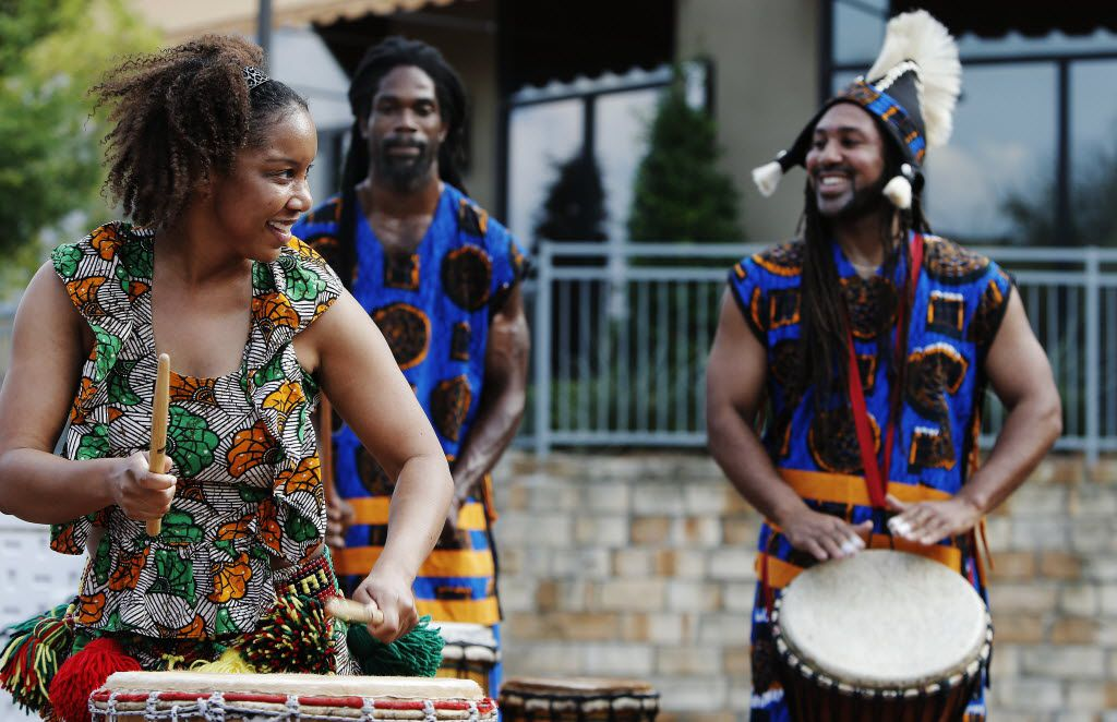 Tony Browne, right, performing with Bandan Koro African Drum & Dance Ensemble at the DeSoto Town Center Amphitheater and Plaza in 2013.