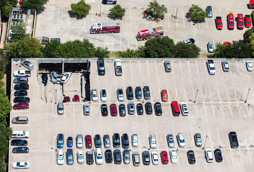 Emergency crews respond to a collapsed parking garage at 4545 Fuller Road in Irving on Tuesday, July 31, 2018.