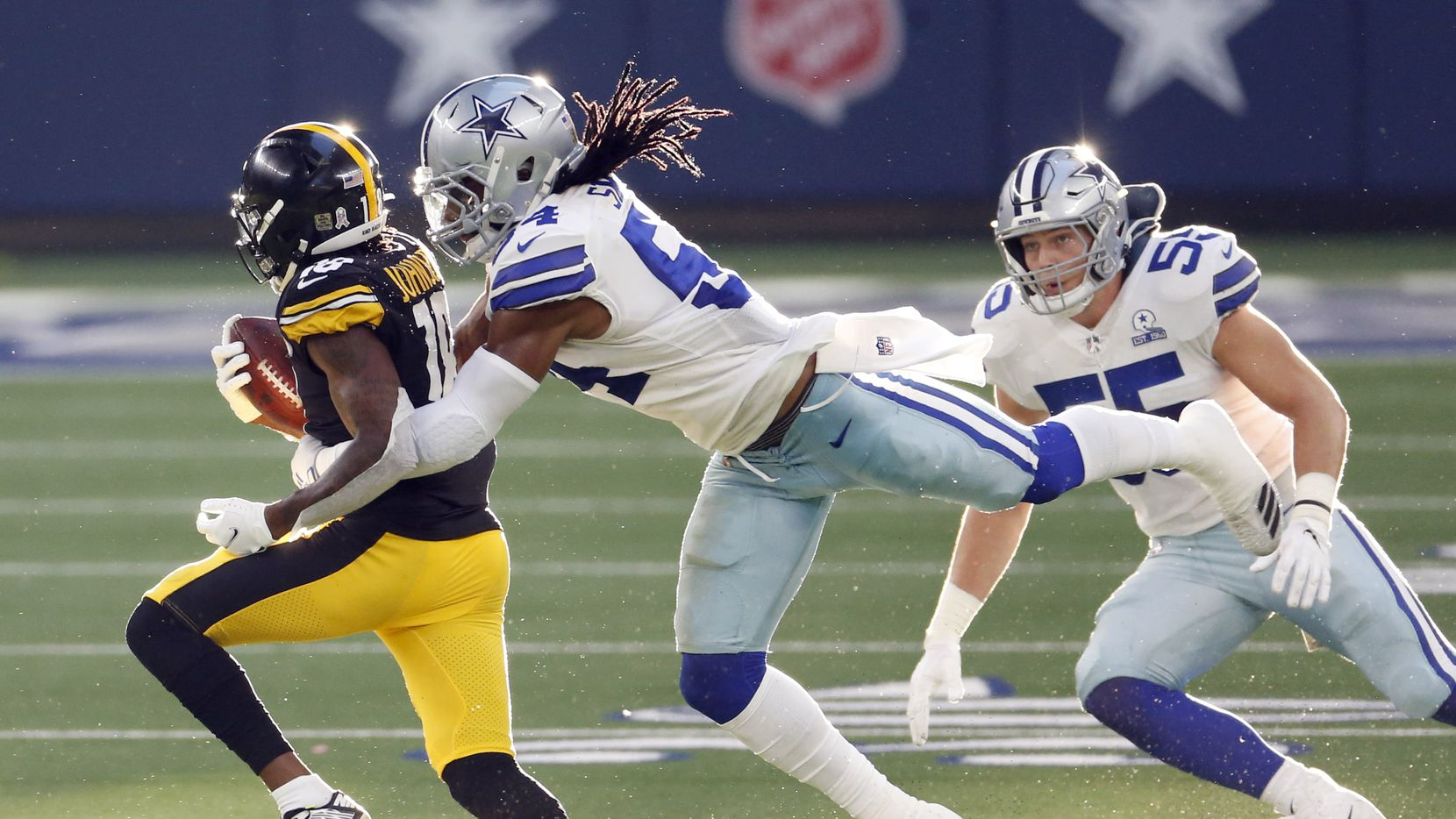 Dallas Cowboys middle linebacker Jaylon Smith (54) tackles Pittsburgh Steelers wide receiver Diontae Johnson (18) as Dallas Cowboys outside linebacker Leighton Vander Esch (55) closes in on the play during the second quarter of play at AT&T Stadium in Arlington, Texas on Sunday, November 8, 2020.