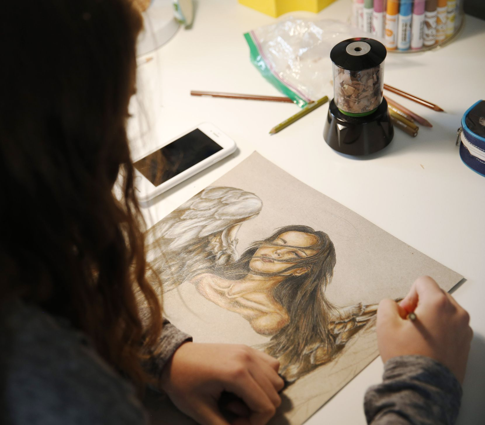 Lilly Heit, 16, works on a project for her AP art class at her Frisco home. Her mother, Jamie, said the coronavirus pandemic almost certainly will lead to the cancellation of trip to San Marcos that Lilly won in a statewide art competition.