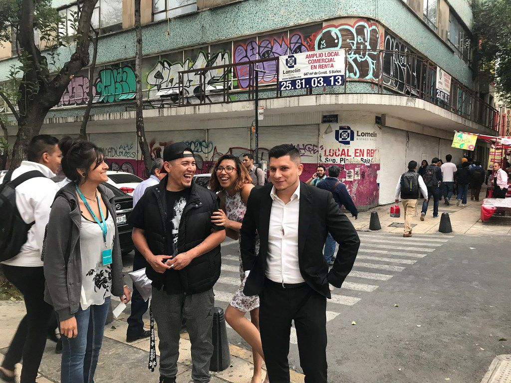 From left to right, Maria Herrera, Jorge Niño, Jeimmy Leyva and Israel Concha walk the neighborhood known as Little LA. on April 23, 2018, in Mexico City. All formed an NGO known as New Beginnings, Nuevos Comienzos to help Mexicans repatriated from the United States.