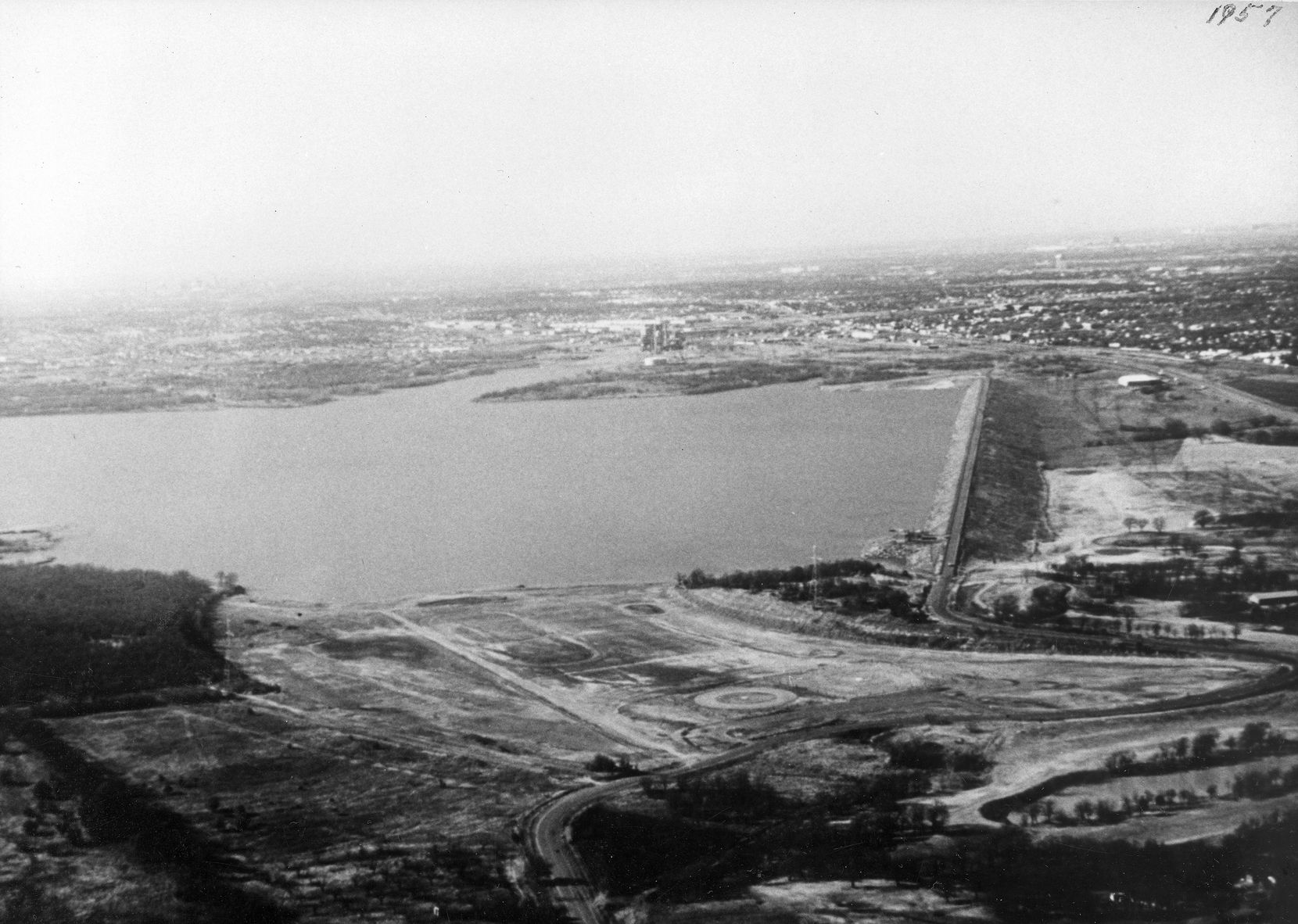 This is a 1957 aerial view of the newly filled Lake Arlington and the Lake Arlington dam. It's believed that the lake covers the area where the 1841 Battle of Village Creek took place.