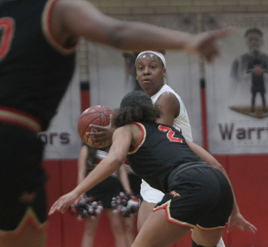 Arlington Martin's Mariah Roberts (5) eyes the South Grand Prairie defense as she is guarded by Ahrianna Morgan (2) during first half action. The two teams played their District 8-6A  girls varsity basketball game at Arlington Martin High School in Arlington on January 26, 2021. (Steve Hamm/ Special Contributor)