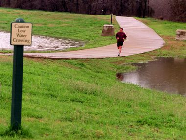 A jogger runs along Campion Trail in north Irving. The city ranks 82nd out of 100 of the largest cities in the U.S. for health and fitness, according to a national fitness index.