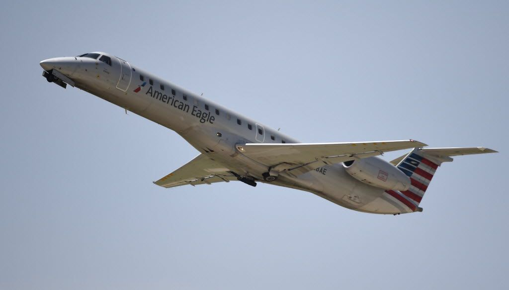 An American Eagle plane takes off at Dallas-Fort Worth Airport  on July 1, 2014.