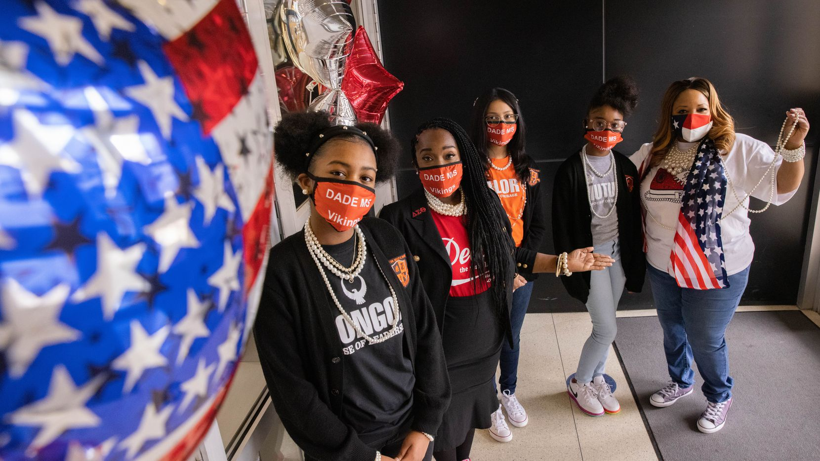 From left: Shanna Austin, Principal Rockell Stewart, Camila Saavedra, Tiambra Hunt and Campus Coordinator Vonda Pipkin pose for a photo at Billy Earl Dade Middle School in Dallas on Inauguration Day. Students and staff at the school wore Chucks and pearls to celebrate Kamala Harris, the first woman of color to be sworn in as vice president.