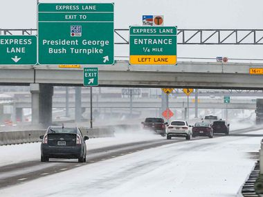 Traffic on Texas 114 TEXpress near MacArthur Blvd Winter flurries arrive in Irving on Sunday, February 14, 2021 ahead of major snowstorm.