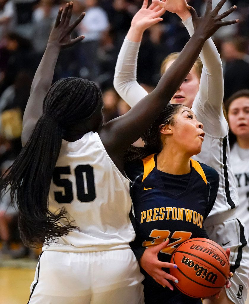 Prestonwood Christian guard Jordan Webster (32) tries to drive between Bishop Lynch guard Paige Bradley (15) and Ayen Angoi (50) during a TAPPS 2-6A high school girls basketball game on Friday, Feb. 7, 2020, in Dallas. Bishop Lynch won the game 59-54. (Smiley N. Pool/The Dallas Morning News)