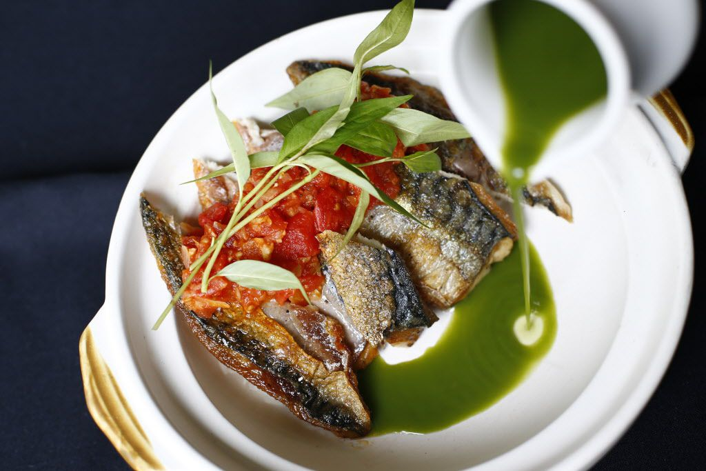 Mackerel with spicy tomato and spicy coriander sauce, garnished with rau ram (Vietnamese coriander)