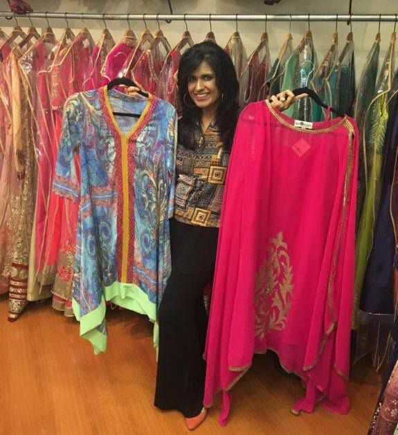 Ruby Bhandari with some of the clothing she designs for her Dallas-based company Silk Threads.