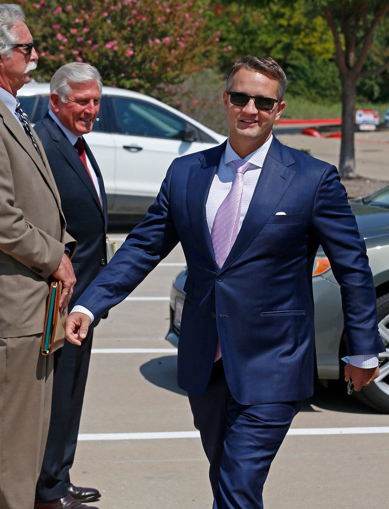 Wade Blackburn (right) left the federal courthouse in Plano after his sentencing hearing on Sept. 14.He pleaded guilty in April to one count of conspiracy to commit mail fraud in connection with the land deals with the Texas Department of Transportation in Denton County.
