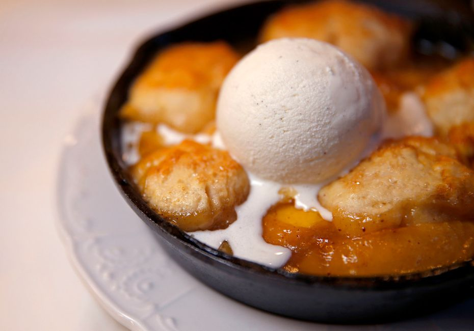 The Texas peach cobbler at Billy Can Can comes with brown-butter drop biscuits and buttermilk ice cream.