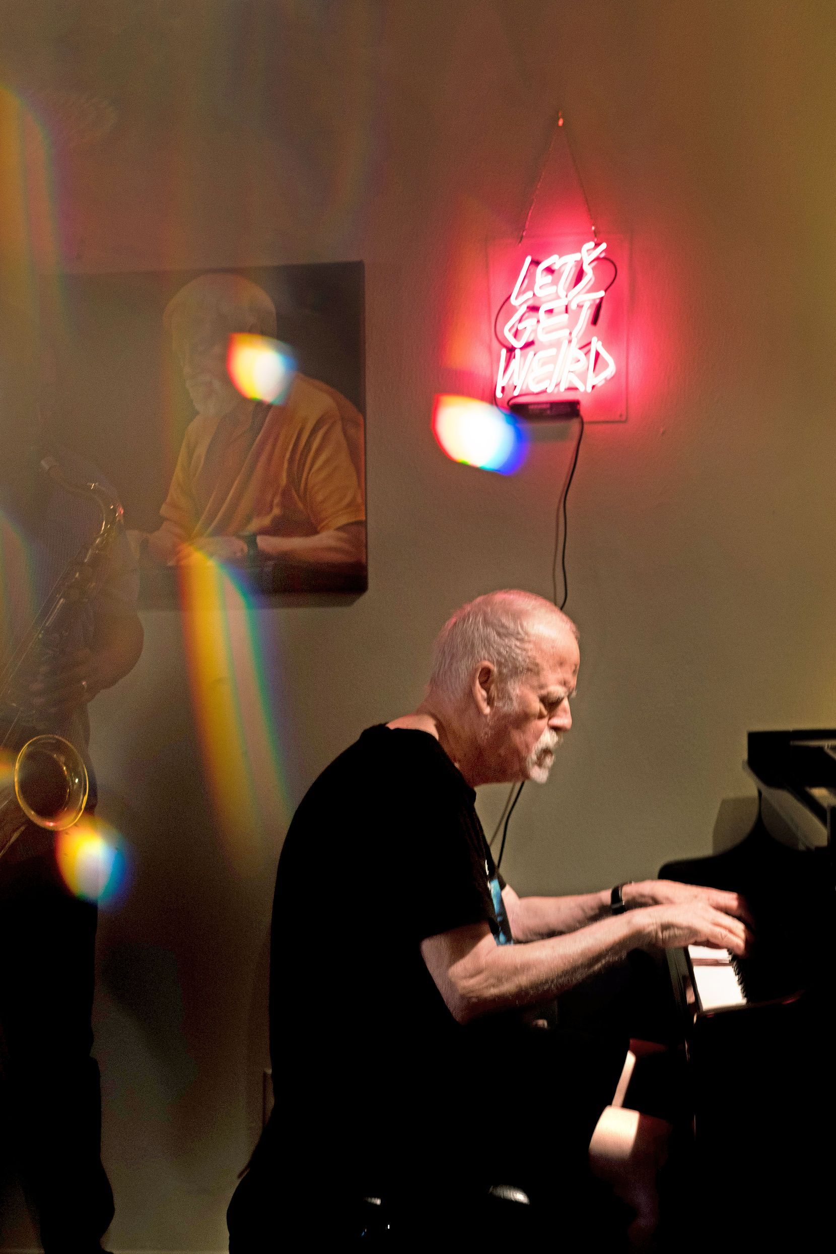 A photo taken through a prism shows Dave Zoller playing piano in his living room on Friday, August 14, 2020 in Dallas.