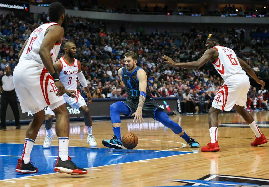 Dallas Mavericks forward Luka Doncic (77) drives in for a shot during the first half a matchup between the Dallas Mavericks and the Houston Rockets on Sunday, March 10, 2019 at the American Airlines Center in Dallas. (Ryan Michalesko/The Dallas Morning News)