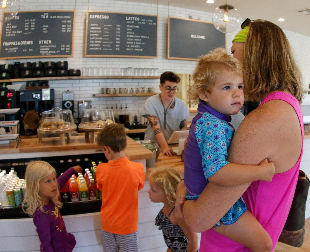Campbell Burke, 4, far left in purple, ask her mom, Sarah Burke, who is holding Gwyneth Burke, 2, if she can have a juice at the new George Coffee + Provisions in Coppell, Texas Thursday morning July 20,2017. In line choosing their drinks are Titus Abrigg, 8, center in orange, and Liza Abrigg, 4, as barista Mallory Crocker whats to take everybody's order  (Ron Baselice/ The Dallas Morning News)