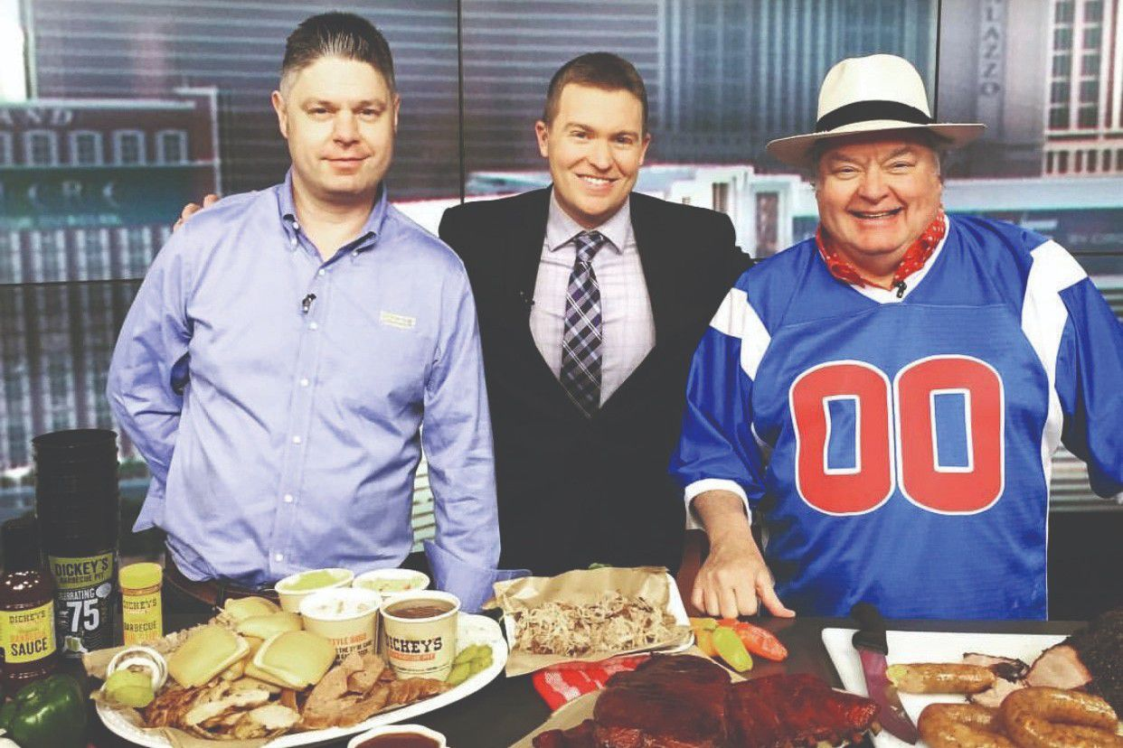 Roland Dickey Jr. and Mr. Dickey talking barbecue and the Super Bowl with a Las Vegas news anchor.