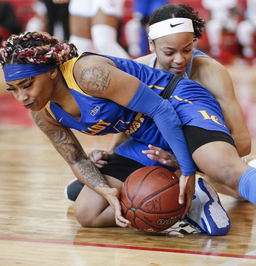 Lakeview Centennial junior Carly Gates, left, and Skyline freshman Naiya Carney battle for the ball during a girls basketball first-round playoff game at Hillcrest High School in Dallas, Saturday, February 13, 2021. (Brandon Wade/Special Contributor)