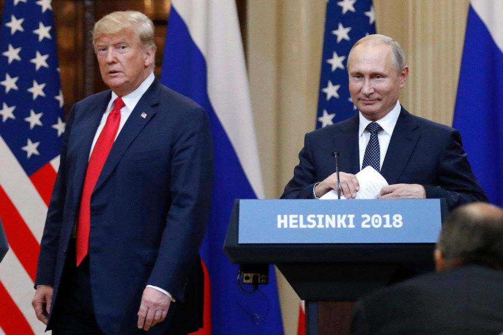 President Donald Trump and Russian President Vladimir Putin arrive for a press conference after their meeting  in Helsinki, Finland.  (Alexander Zemlianichenko/The Associated Press)