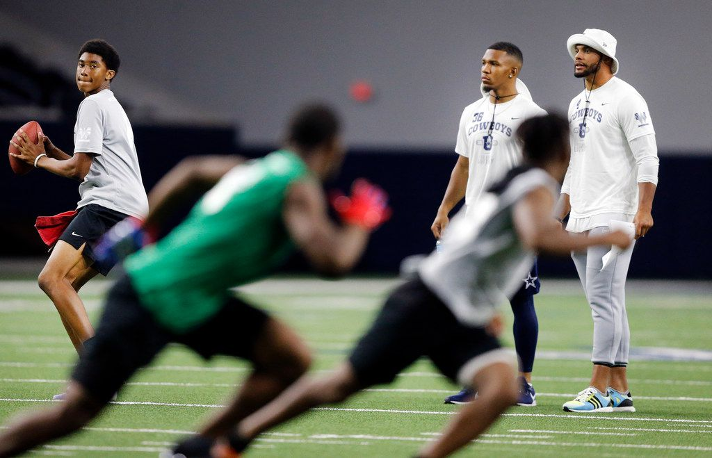 Dallas Cowboys quarterback Dak Prescott (right) and running back Tony Pollard watch their Silverback #HotBoyz run a play during the Cowboys U high school football championship game in the Ford Center at The Star in Frisco, Texas, Thursday, June 6, 2019.  Cowboys players serve as coaches to select high school players during the football camp. The Dallas-Fort Worth student-athletes were selected by their respective high school football coaches and district athletic directors to attend the camp. The nearly 200 students represent 52 North Texas high schools from 12 different school districts. (Tom Fox/The Dallas Morning News)