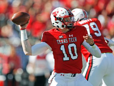 Texas Tech's Alan Bowman (10) passes the ball down field during the first half of an NCAA college football game against Kansas, Saturday, Oct. 20, 2018, in Lubbock, Texas.