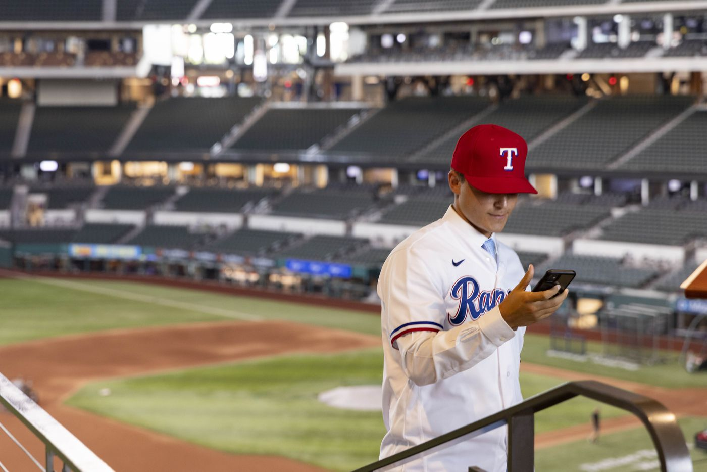 Jack Leiter (left) from Vanderbilt University looks at a selfie he took following a press conference announcing his signing to the Texas Rangers on Tuesday, July 27, 2021, at Globe Life Field in Arlington. Leiter was the club's 2021 MLB Draft first round selection and the draft's second overall pick. (Juan Figueroa/The Dallas Morning News)