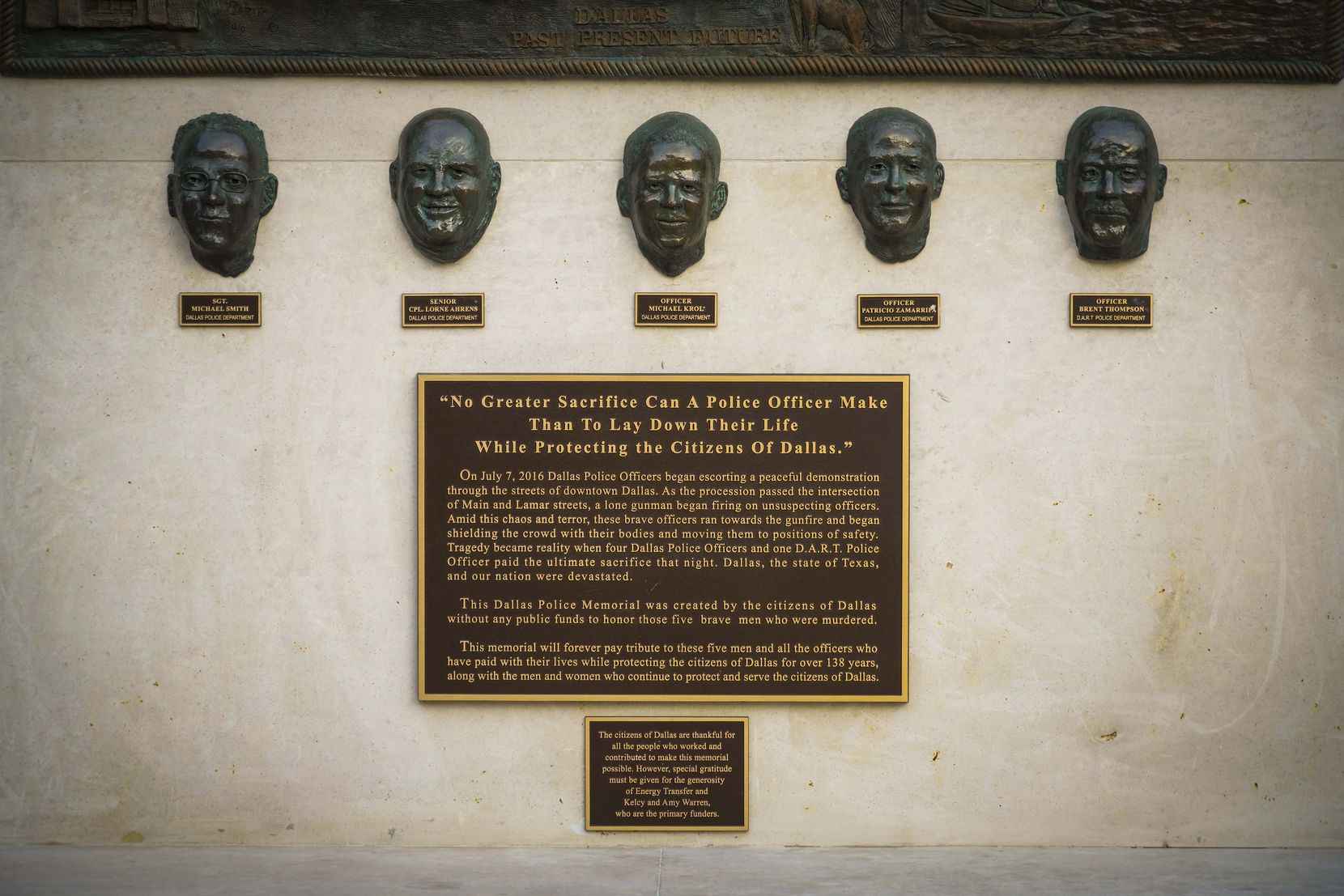A memorial outside Dallas police headquarters honors the five officers — four Dallas police officers and one DART officer — who died on July 7, 2016.