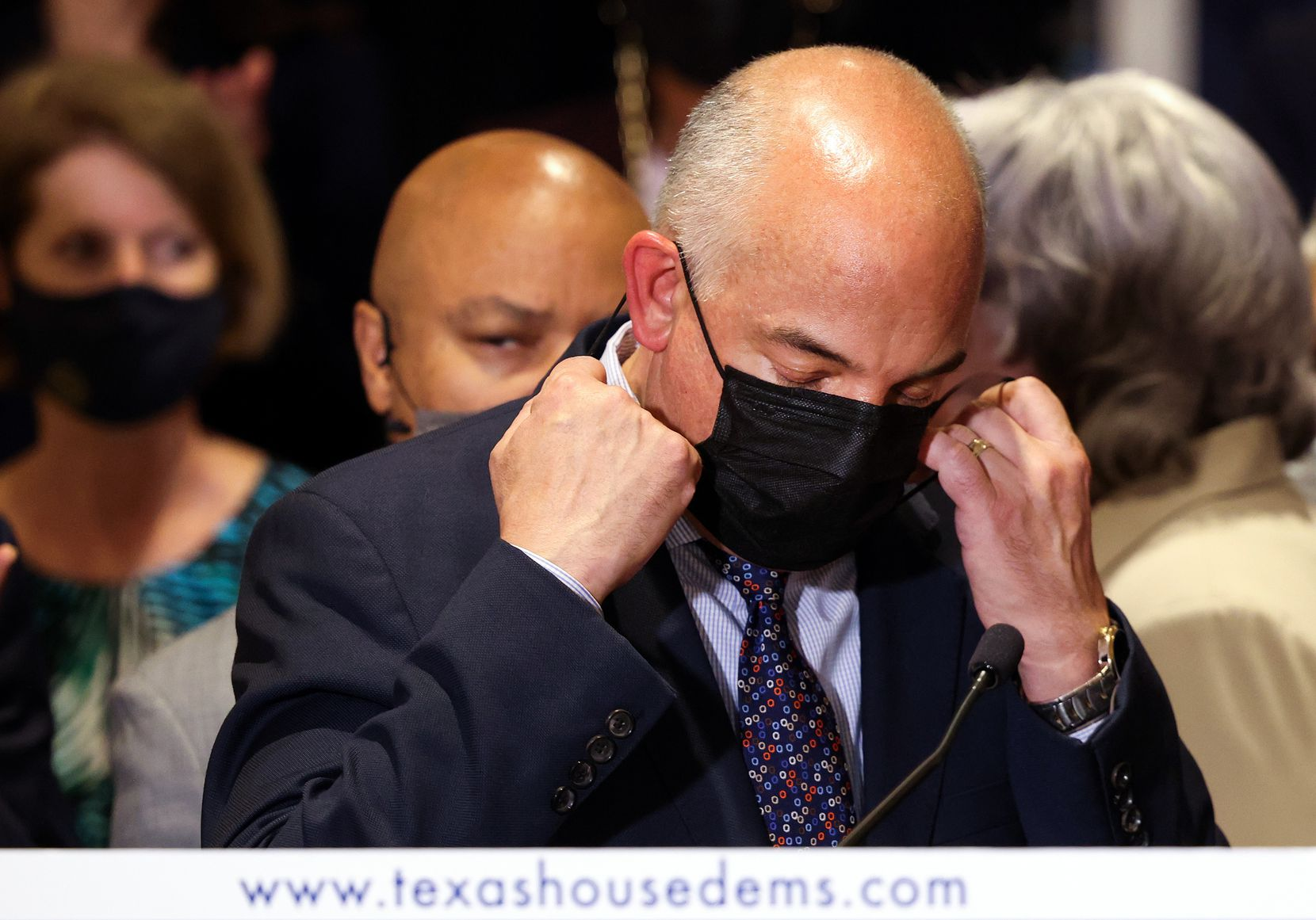 Texas House Democratic Caucus Chair Rep. Chris Turner (D-101), joined by fellow Democratic Texas state representatives, puts on a mask after speaking at a press conference on Texas Gov. Greg Abbott and the group's meetings with federal lawmakers on voting rights, on July 20, 2021 in Washington, DC. Members of the Texas House Democratic Caucus continue to lobby for voting rights reform in Washington, DC after leaving Texas to block a voting restrictions bill by denying a Republican quorum.
