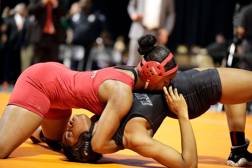 Destiny Miles of Dallas Kimball wrestles during the UIL Texas State Wrestling Championships, Saturday, February 22nd, 2020, at the Berry Center in Cypress, Texas. Miles won the match with a pin.  Todd Spoth/Special Contributor ORG XMIT: hswrestlinglede_0223spo