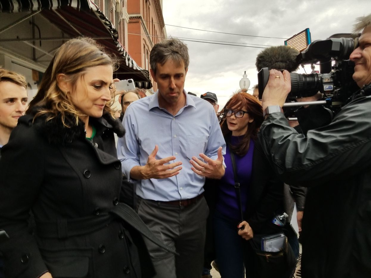 Beto O'Rourke was the focus of attention as he left a campaign stop in Burlington, Iowa, on Thursday. At right is his aide Cynthia Cano.