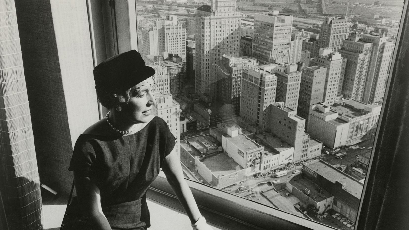 Ebby Halliday, founder of her namesake company, overlooks downtown Dallas in 1956.