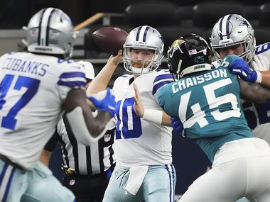 Dallas Cowboys quarterback Cooper Rush (10) throws a pass to tight end Nick Eubanks (47) as offensive guard Connor McGovern (66) works against Jacksonville Jaguars linebacker K'Lavon Chaisson (45) during the first half of a preseason NFL football game at AT&T Stadium on Sunday, Aug. 29, 2021, in Arlington.