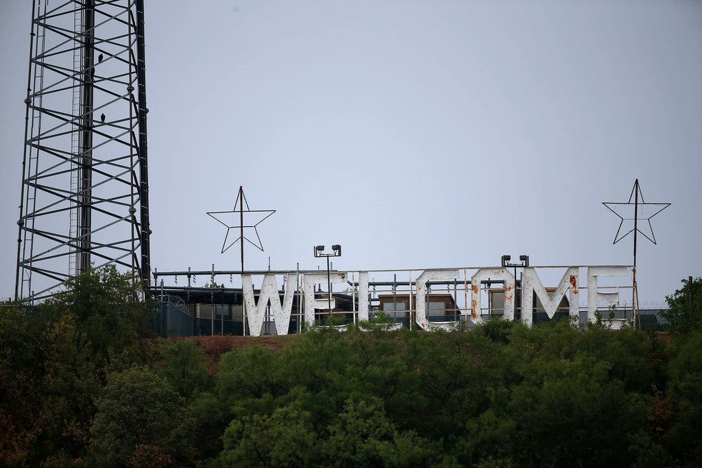 A welcome sign on the top of a hill in Mineral Wells has seen better days.