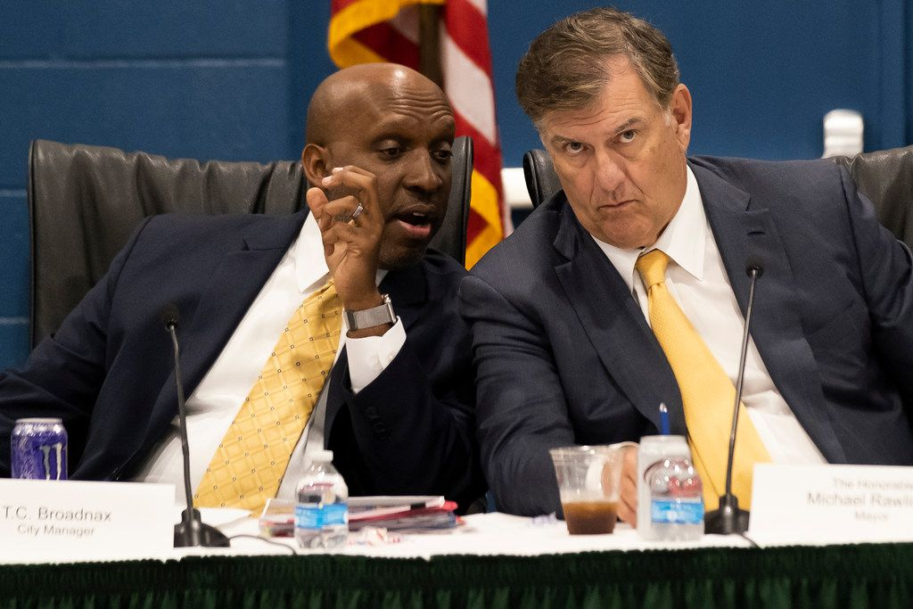 Dallas Mayor Mike Rawlings confers with city manager T.C. Broadnax as the Dallas City Council holds an offsite agenda meeting at the Kleberg-Rylie Recreation CenterDallas on Wednesday, May 8, 2019, in Dallas. (Smiley N. Pool/The Dallas Morning News)