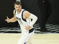 Dallas Mavericks guard Luka Doncic celebrates a 3-pointer during the first quarter of Game 7 of an NBA playoff series against the LA Clippers at the Staples Center on Sunday, June 6, 2021, in Los Angeles.