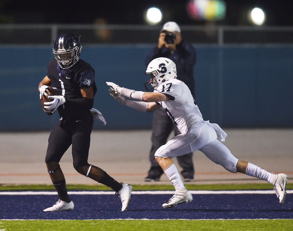 Liberty Christian wide receiver Jaelin McCoslin (1) catches a touchdown pass in front of All Saints Episcopal defender Easton Fehler (17) during their game Friday October 26, 2018, in Argyle, Texas. Photo by Al Key/For the DRC