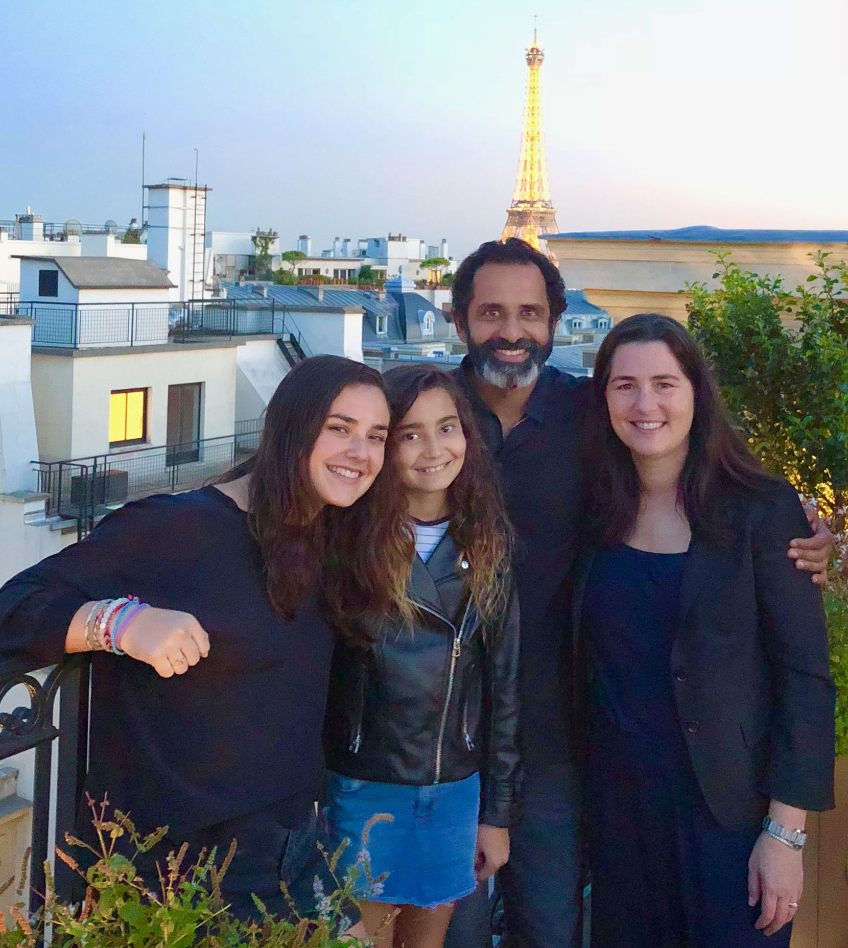 This family photo shows (from left) daughters Talia and Maya with Madhu Rajendran and Mandy Ginsberg on a family vacation to Paris in 2019.
