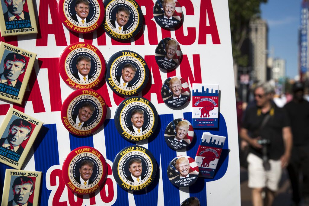 Vendors sell campaign buttons along Euclid Street on the third day of the Republican National Convention.
