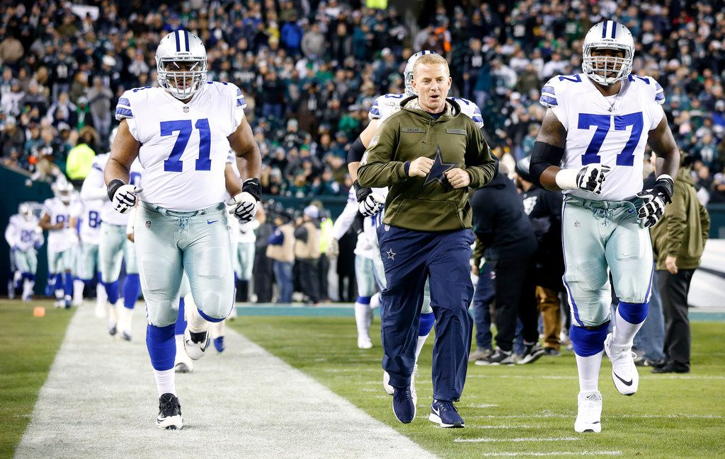 FILE - Cowboys head coach Jason Garrett leads offensive tackles La'el Collins (71), Tyron Smith (77) and the rest of the team onto the field to face the Eagles at Lincoln Financial Field in Philadelphia on Sunday, Nov. 11, 2018