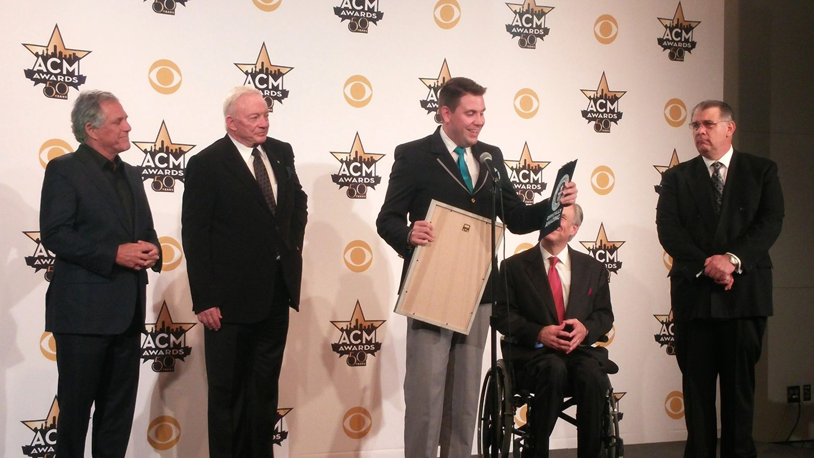Supporters of the ACM Awards' Guinness World Record included Jerry Jones (second from left) and Gov. Greg Abbott (second from right).
