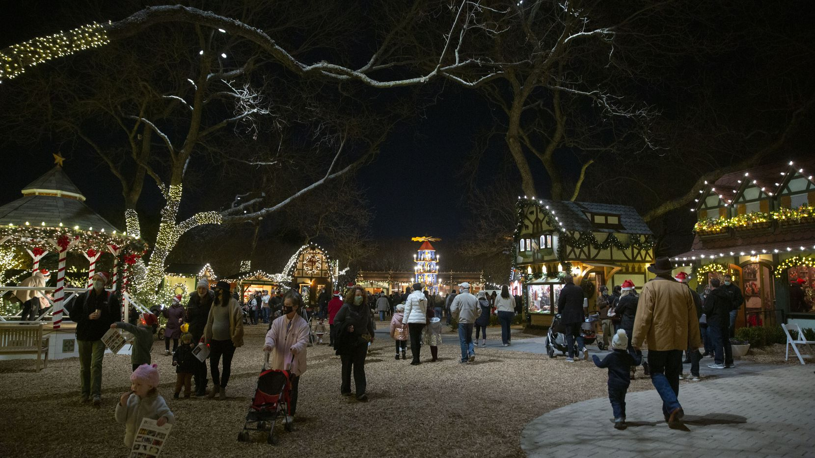 The Christmas Village at Dallas Arboretum includes a German Christmas pyramid and quaint shops, inspired by Christkindlmarkt.